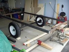 This guy built his own utility trailer.  I don't know how to weld, but this gives ideas of what to look for in a utility trailer.
