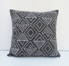 Charcoal cotton canvas pillow cover embroidered with aztec pattern in white colour The charcoal canvas fabric is stonewashed to give it a chalkboard look. The aztec pattern is created using fletching embroidery - as if made by chalk on chalkboard.  The back is plain stonewashed charcoal colour cotton canvas to match the front.  The throw pillow cover has zip closure. All inside seams are finished for no fraying.  This listing is for the cover only. You can find the pillow inserts listed…