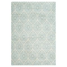 Lend a pop of pattern to the den or master suite with this stylish rug, showcasing a medallion-inspired motif in alpine and cream.