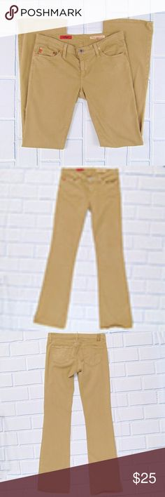 """AG Jeans The Angel Bootcut Stretch Jean Tan Brown The Angel Bootcut Jean from AG Jeans Outlet in a camel brown color. Stitched pockets AG Khaki patch on back Traditional 5-pocket style Stretchy  Excellent Used Condition with no major signs of wear!! Free of stains or rips. See images.  Measurements (laid flat, unstretched): Waist 15.5"""" Inseam 33"""" Outseam 41"""" Hips 17.5"""" Front Rise 7.5"""" Back Rise 12.5"""" Leg Opening 9""""  Questions? Offers Welcome? Ag Adriano Goldschmied Jeans Boot Cut"""