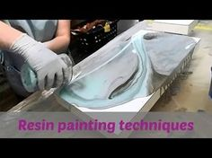 Learn how to 'dirty pour' resin mixed with colorants such as different kinds of paint, alcohol ink and other household items to create unique resin paintings...