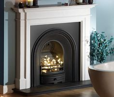 The Kensington marble fireplace in Liberty White Marble Carlisle black cast iron arch, shown without a fire (decorative lights not included), honed granite hearth (slabbed for multi-fuel) Dimensions: Width: Height: Marble Fireplace Mantel, Cast Iron Fireplace, Marble Fireplaces, Fireplace Mantels, Fireplace Ideas, Fireplace Surrounds, Granite Hearth, Fire And Stone, Victorian Fireplace