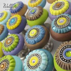 polymer clay hand-sculpted knobs by Wellcraft Handmade. Check the site for beautiful jewelry work as well.