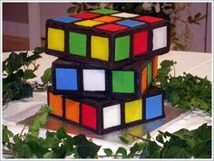 Rubik's Cube cake. This is soooo cool. And with cake on boards and fondant... this would be really easy to do. LOVE IT.