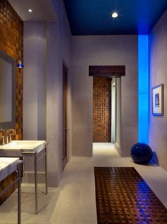Modern House with Arabian Window style: Beautiful Corridor With Wash Stand And Blue LED