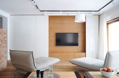 8 TV Wall Design Ideas For Your Living Room // The large TV in this minimal living room is the focal point in this room. Living Room Tv, Tiny Living, Living Spaces, Colorful Apartment, Tv Wall Design, White Paneling, Rooms Home Decor, Entertainment Room, Apartment Design
