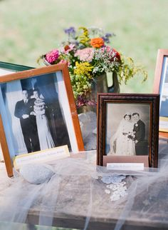 family wedding photos on a table...did this at my wedding and it meant a lot to both families