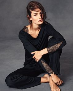 """Hanro """"Constance"""" two-piece flowing jersey pajama set, featuring delicate Chantilly lace trim. Boat neckline. Long sleeves. Lace shoulders and cuffs. Relaxed silhouette. Includes matching pull-on pants. MicroModal® rayon/silk; nylon/spandex lace. Imported."""