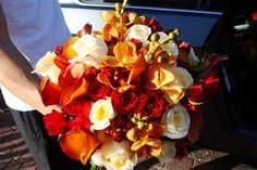 Autumn / Fall Wedding bridal Bouquet - rust colored calla lilies, orange orchids, red spray roses and red hypericum berries and 'Vendela' cream roses.