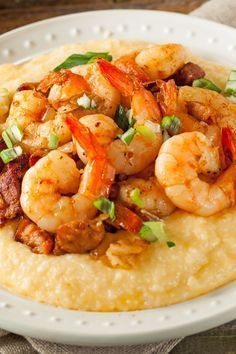 Recipe including course(s): Entrée; and ingredients: bacon, black pepper, butter, garlic, green onion, grits, lemon juice, parsley, salt, sharp cheddar cheese, shrimp, water