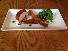 Goats Cheese, roasted red pepper & brushetta with a side salad garnish