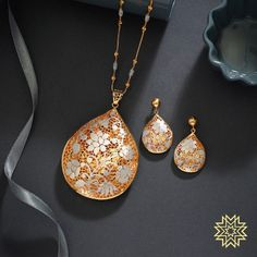Gift yourself an intricate weave of flowers. Pendant Set, Gold Pendant, Pendant Jewelry, Gold Earrings Designs, Gold Jewellery Design, Necklace Designs, Black Hills Gold Jewelry, Gold Jewelry Simple, Manubhai Jewellers