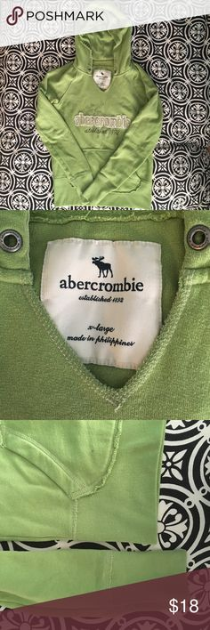 Abercrombie green hoodie Kids size XL - will fit Women's XS-S. Cotton, waffle pattern inside hood, stylized frayed edges on front pocket, ribbed cuffs on sleeve and bottom bands. In great shape! Very soft and comfy. abercrombie kids Shirts & Tops Sweatshirts & Hoodies