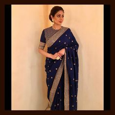 Stunning Sridevi Kapoor wears a royal blue silk matka saree meticulously hand-embroidered by master craftsmen from West Bengal. Accessorised with uncut diamond jewellery set in 22k gold from the Sabyasachi Jewelry collection. For all jewellery related queries. 05 December 2017