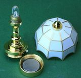 The solid brass construction of the Sutton Miniatures table lamp unscrews at the base to open the battery case. The lamp shade unscrews from the base of the LED.