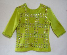 Artist dyed cotton jersey, sequins silver, red and green embroidery thread. May 2018