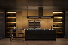 brass-cabinetry-kitchen-marbled-kitchen-bench-amber-lit-shelving
