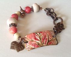 ABS-June Created this fun bracelet using SuzieQBeads Connector, Gaea ceramic beads, Vintaj Leaves and misc beads and findings. I Love Jewelry, Clay Jewelry, Metal Jewelry, Jewelry Crafts, Beaded Jewelry, Jewelry Design, Jewelry Making, Beaded Bracelets, Ceramic Jewelry