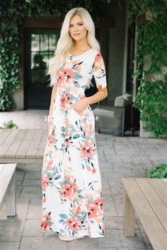 Meet The Makenna, a NeeSee's Dresses exclusive! You will not find this dress at any other boutique! Adorable maxi dress features half sleeves, and a gathered waist with flattering front pockets. Ivory dress features a tropical floral print.
