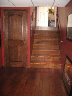 Love the look of this old looking hardwood on the stairs.