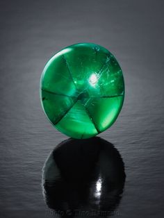 Trapiche Emeralds found in Colombia, are distinguished by the six-pointed radial pattern that is caused by carbon impurities. #Gemstones #Emerald www.ArtisanJewelers.biz #Sarasota