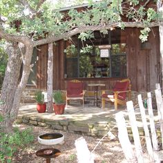 The Oak Cottage, our most secluded cottage, this porch looks into the woods, there is a fire pit to enjoy on cool evenings.#Texas Hill Country