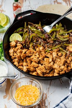 Skillet chicken fajitas are made in a cast-iron skillet with thinly sliced chicken and sauteed peppers and onions, all tossed in a blend of your favorite Mexican spices. It's the perfect base of a fajita just waiting to be topped with sour cream, avocado, cheese, jalapenos, you name it. Super easy to prep a lot ahead of time and everyone will absolutely love. #chickenfajitas #skilletfajitas #mexicanrecipes #skilletchickenfajitas