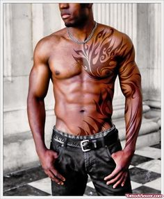 Red Ink Tribal Tattoo On Man Chest and Left Sleeve