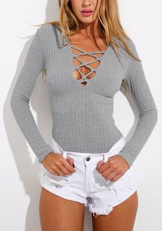 Look like the hottest thing in this stretchable grey ribbed lace-up bodysuit. It features back zipper for easy wear and a five-snap closure at bottom.   Lookbook Store
