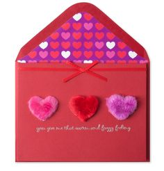 """Give this """"warm and fuzzy"""" Valentine's Day card to your sweetheart. The card features three fuzzy fur hearts, a ribbon box detail at the top and text printed in silver foil."""
