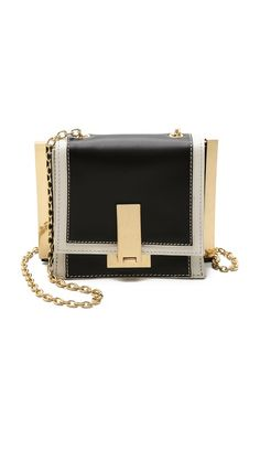 Contrast leather and polished gold-tone hardware detail a small ZAC Zac Posen cross-body bag. A turn lock opens the front flap to a gusseted interior with 2 lined compartments and a card pocket. Chain shoulder strap. Dust bag included. @Shopbop