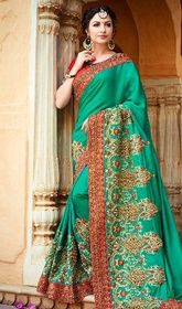 Sky Green Color Shaded Chiffon Silk Designer Sari #designersareeswithprice#expensivedesignersarees You will be confident to make a effective fashion statement with this sky green color shaded chiffon silk designer sari. You can see some intriguing patternsaccomplished with lace, patch and resham work. Upon request we can make round front/back neck and short 6 inches sleeves regular saree blouse also. USD$ 228(Around £ 157 & Euro 173)