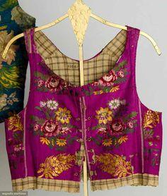 SILK BROCADE FOLK VESTS, 19TH C In jewel tones w/ floral brocade, 1 boned & several w/ gilt trims