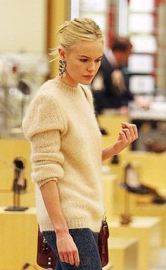 A Luxe and cuddly mohair sweater with an oversize fit and nude color make it urbane yet delicate. Toughen up the famously soft knit with lightly acid-washed jeans. Pair with statement earrings and pulled back hair.