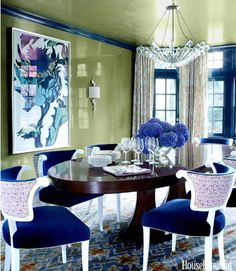 In a traditional Tudor house decorated by Sara Gilbane in Rye, New York, a pedestal table from Century Furniture is surrounded by dining chairs from Hickory Chair, in a Schumacher mohair-velvet with Carolina Irving's Andaluz on the backs. Rug by Stark. - HouseBeautiful.com