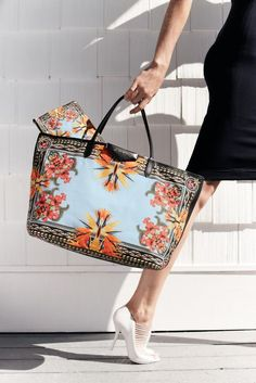 Pump up your outfit of the day with a floral bag! You'll have everyone swooning over your look!