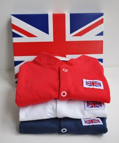 Stunning pack of 3 red, white & blue Brit-Baby babygrows! Includes a Union Jack gift box.