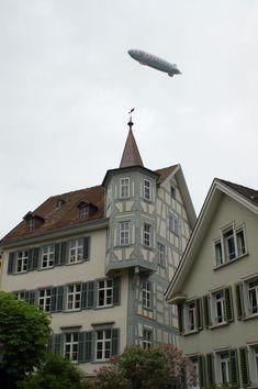 Building in centre of St. Gallen, with Zeppelin flying over