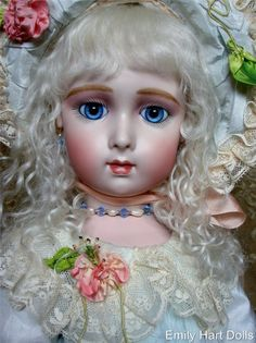Added because of the beautiful Antique laces and hand made silk ribbon flowers...Precious Long Face Jumeau with Applied ears sold and sent to Japan