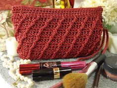 Pretty and practical gift idea...the Whimsical Clutch. Make one yourself from a crochet pattern. Use as a makeup bag, pencil case, or clutch.