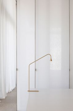 Penthouse in Belgium, brass table lamp, sophisticated brass lamp, brass accents in interior