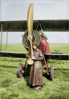 Katherine Stinson and her plane in Brooklyn after completing a flight from Chicago. June 1, 1918.