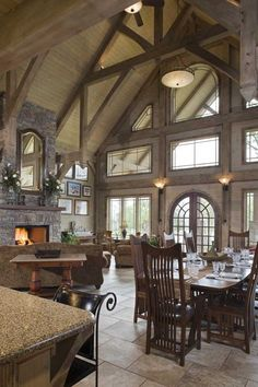 I love how open and rustic this living doom, kitchen and dining room are. The exposed beams are also my favorite.