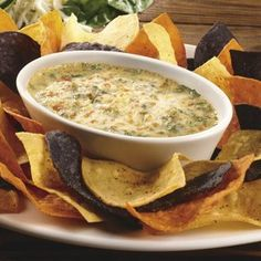 Copycat Recipe to try: Hot Spinach (+ Artichoke) Dip with cheese, served at Longhorn Steakhouse..... freakin delicious. Link has hundreds more recipes and restaurants!