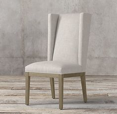 RH's Stewart Fabric Side Chair:The 1950s wing chair finds a new minimalist interpretation in our solid oak Stewart dining chair. The trim, angular wing rises in a refined wedge, while slim saber legs add to its vertical sensibility.