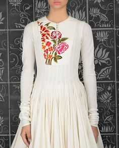 Ivory anarkali kurta with floral embroidered and pin tucked yoke. Round neckline with potli buttons. Long sleeves. Floral embroidery adorn the back. Golden hem. Matching churidar leggings and crinkled dupatta included Wash Care: Dry clean onlyClosure: Zip at side