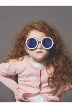 karen walker. kids modeling her sunglasses. amazing.