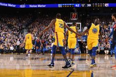 Draymond Green and Kevin Durant of the Golden State Warriors high five during the game against the Oklahoma City Thunder on February 24 2018 at...