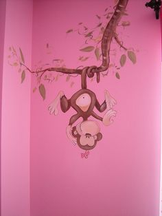 Girls love animals too! This large, pink baby nursery is filled with palm trees and sweet, safari animals including monkeys, giraffes and birds. The crib is framed by a 'bamboo trellis' covered in pink, tropical flowers. I also painted very whimsical Please don't miss our creative baby nursery ideas at www.CreativeBabyBedding.com