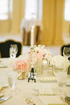 For pink & grey color scheme - small silver bud vases with clusters of pink and white flowers { One candle stick for each number at the table: Table #6 = 6 candle sticks}